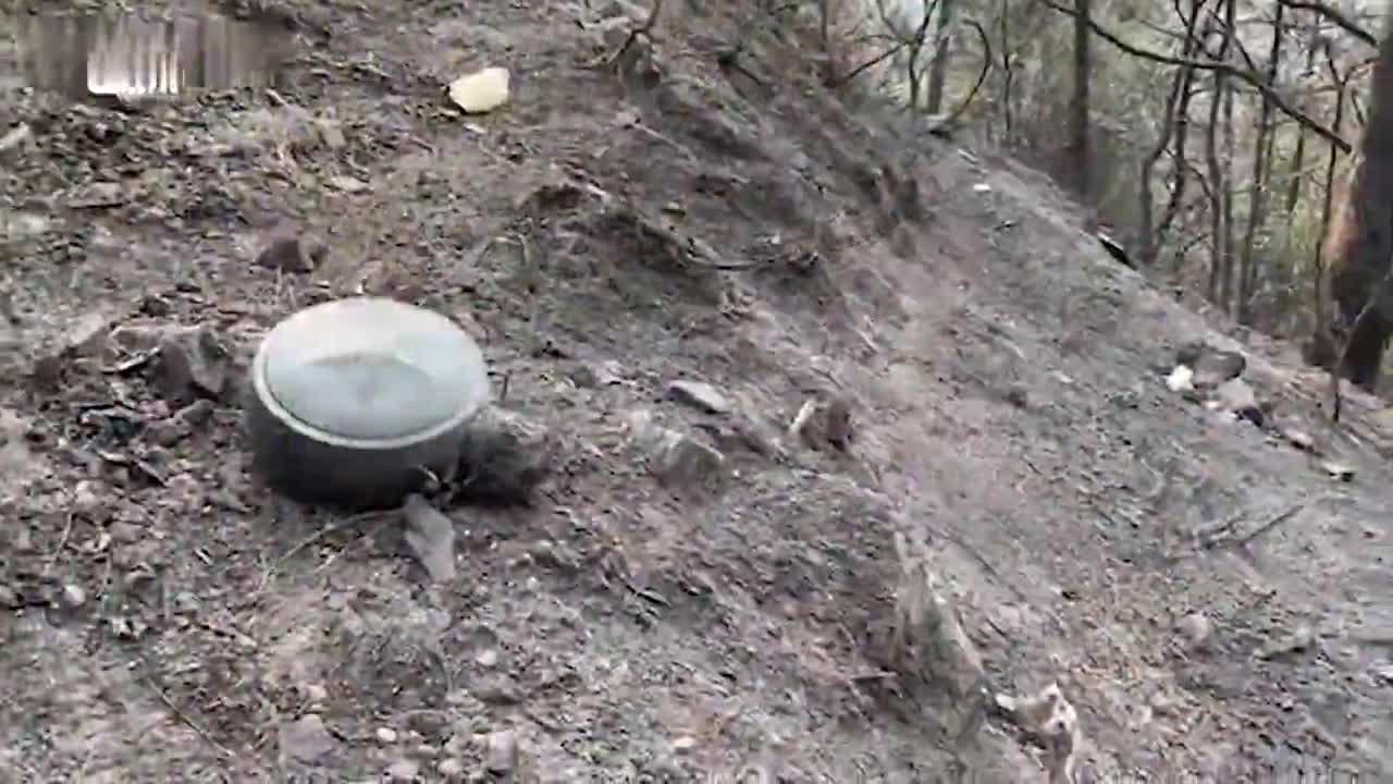 探访西昌19勇士遇难地:灭火器被烧化