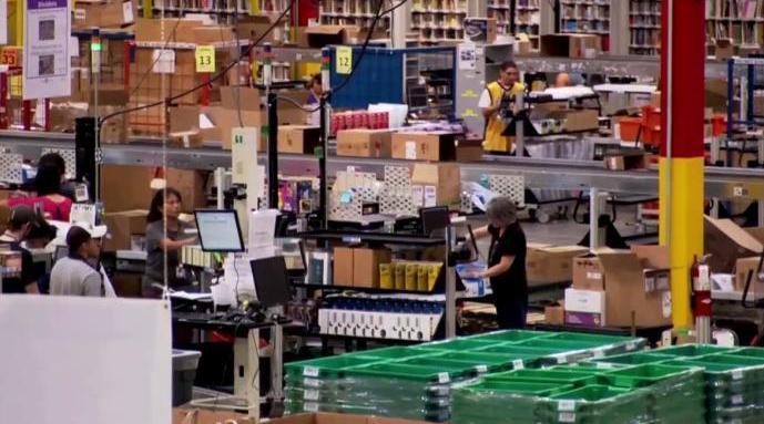 多次罢工后,亚马逊为员工量体温发口罩