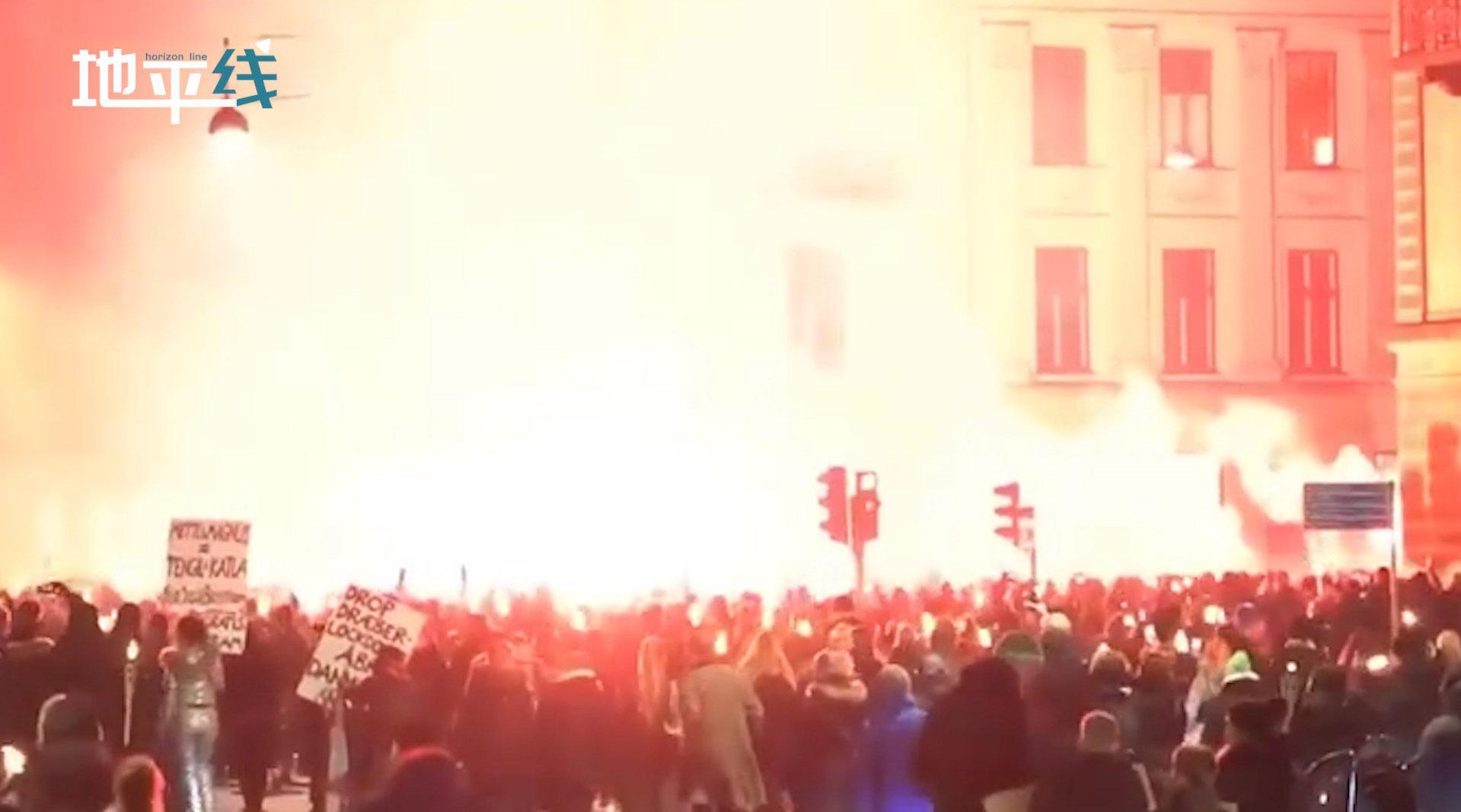 丹麦爆发反封锁火炬游行