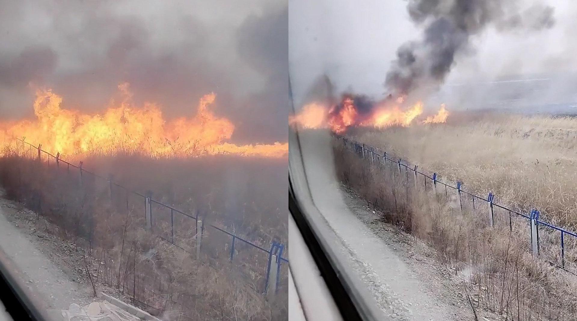 铁路旁起火逼停列车