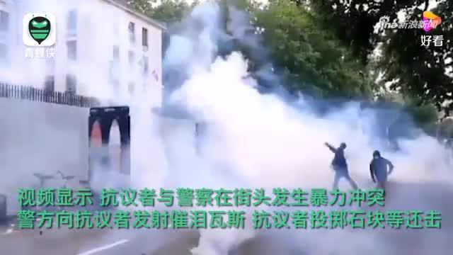 法国国庆日多地现反疫苗游行 抗议者与警方街头对峙