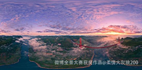 世界山区斜拉桥之最,贵州省黔西县鸭池河特大桥在阳光映衬下的壮美景色,鸭池河特大桥今年也出现在了《厉害了,我的国》纪录片中。