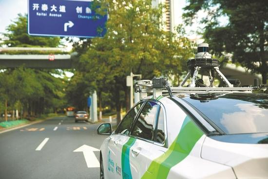 广州街头,运营中的自动驾驶网约车 人民视觉供图
