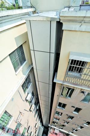 """""""吴达飞表示,这种新型电梯利用钢结构灵活拆卸的特性,进行搭积木式"""