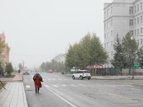 """中国""""最北城市""""下雪了 广东仍高温难耐"""