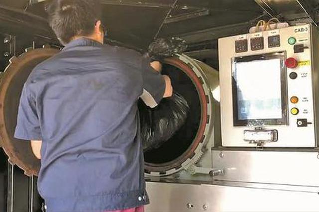 深圳女博士造出智能处理器 大箱子吃进垃圾十分钟吐出肥料