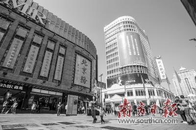 广州传统中轴线提升建设工作一期项目完成,北京路面貌焕然一新。资料图片