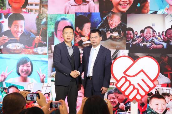 随手科技联合创始人焦义刚和免费午餐基金创始人邓飞