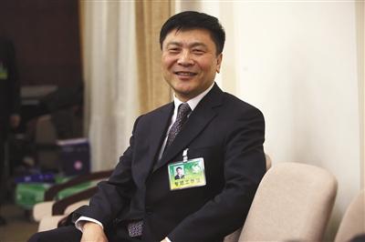 1月13日,北京市人力资源和社会保障局局长徐熙参加两会政务咨询会。 新京报记者 王贵彬 摄