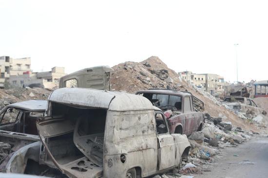 (遭受战争破坏的大马士革  摄影:中国日报 王敬)