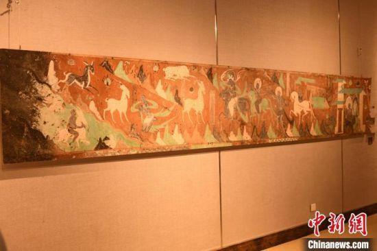 图为莫高窟第257窟壁画《鹿王本生》。 周毅 摄