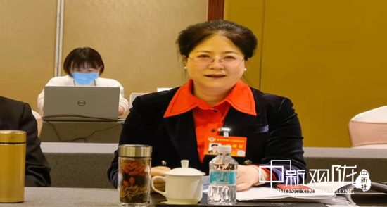 图2为张萍参加会议照。(受访人提供)