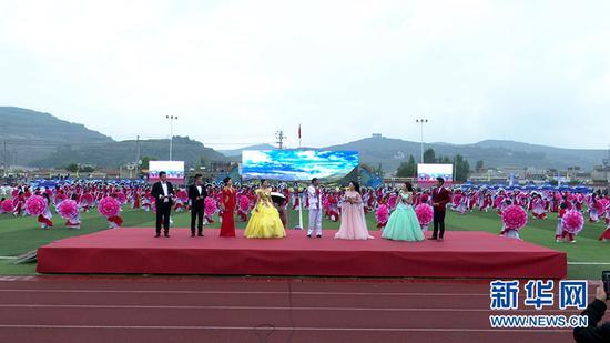 """这是6月24日拍摄的岷县""""花儿艺术节""""现场。岷县融媒体中心供图"""