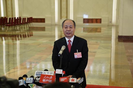国家国际发展合作署署长王晓涛回答记者提问。