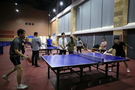新华保险广西分公司举办首届职工乒乓球比赛