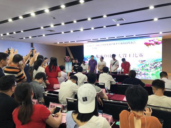 发布会现场还举行了龙滩珍珠李大胃王比赛、产销合作签约仪式