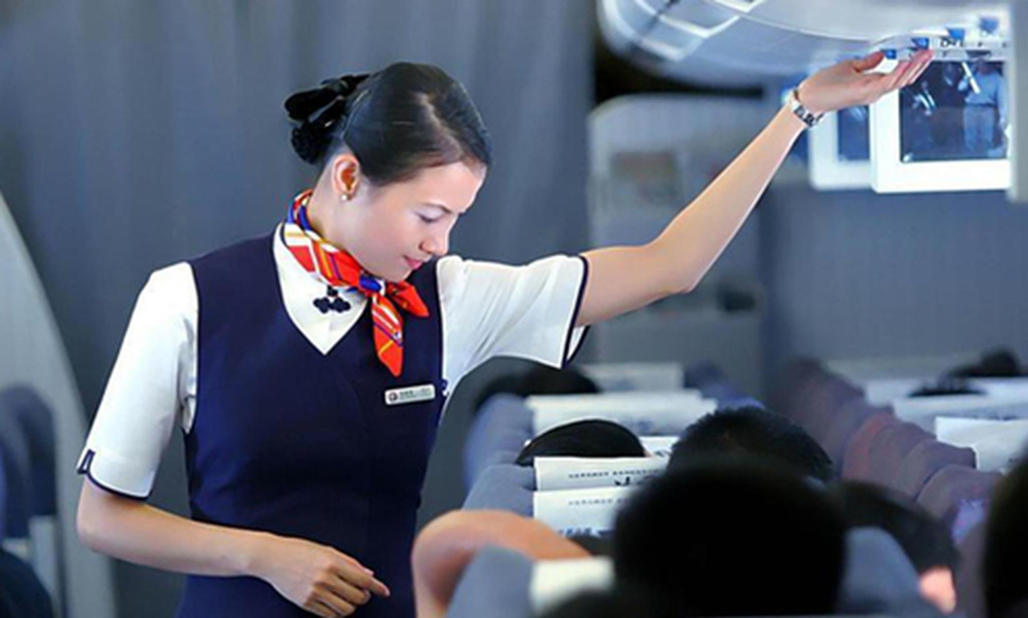 国内航空公司推占座票、伸腿费 你愿意掏钱体验吗?