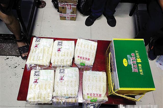 上千克海洛因藏身袋装大米 男子通过物流运毒被抓
