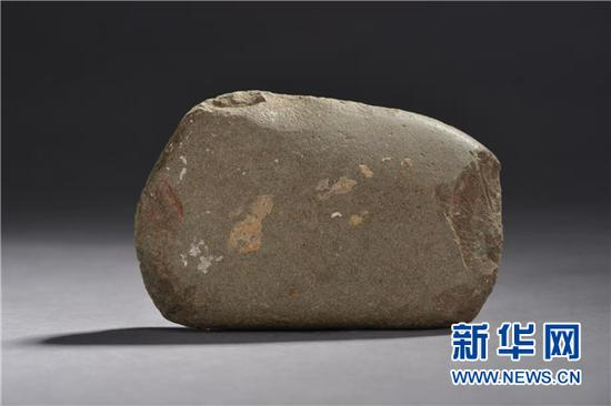 招果洞遗址出土的通体磨光石器。(贵州省文物考古研究所供图)