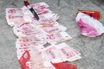湖南男子骑摩托携带23万元假币去重庆 在贵州被查获