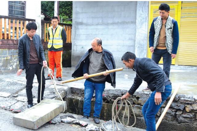 村民抬走高速路边沟盖板修院坝 险被追刑责