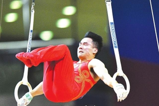 """体操世锦赛中国男团惊险夺冠 贵州选手邓书弟再成""""定海神针"""""""