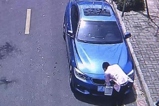 车辆不能进一环 他竟用布套包裹车牌躲监控