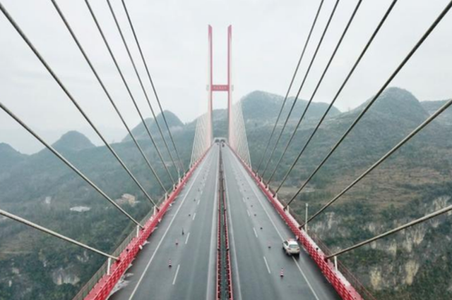 """贵州山区筑桥二十八载的政协委员:""""桥""""连世界"""