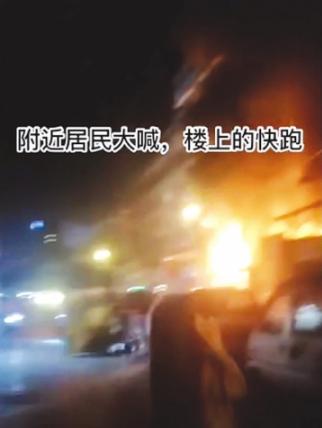 长发女子冲着楼上大喊:起火了,快跑! 视频截图