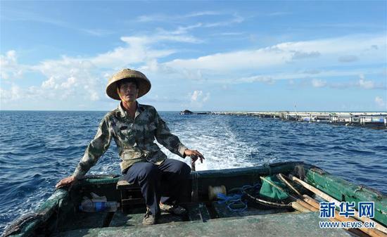 南沙美济礁渔民屯海戍边养殖热带鱼类_新浪海南_新浪网