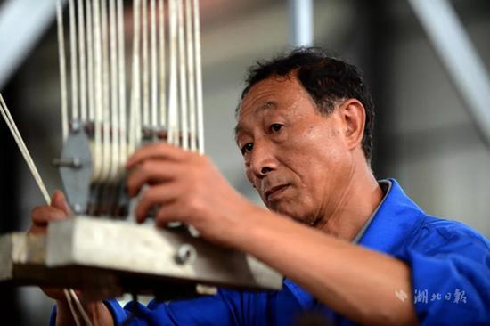 周汉生,男,1960年3月生,中国一冶集团有限公司安装起重工,高级技师