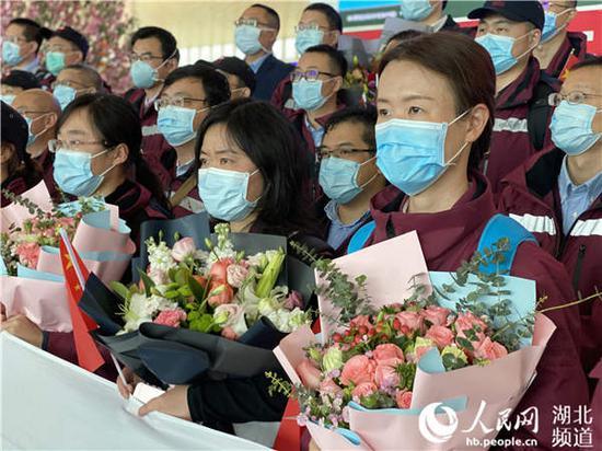 74名援汉疾控队员圆满完成任务顺利返京。(肖璐欣 摄)