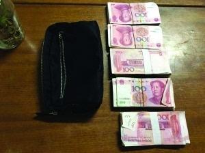 男子坐出租车掉30万现金 武汉的哥捡到主动报警归还