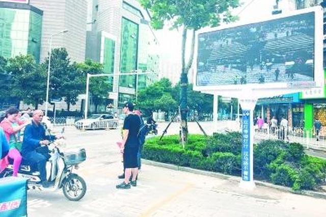 武汉行人闯红灯将曝光大头照 被拍者将进诚信黑名单
