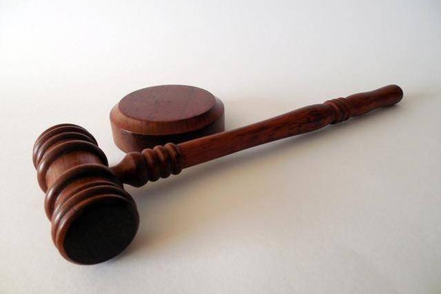 武汉女官员被法院传唤当日自杀 法院宣布终止审理
