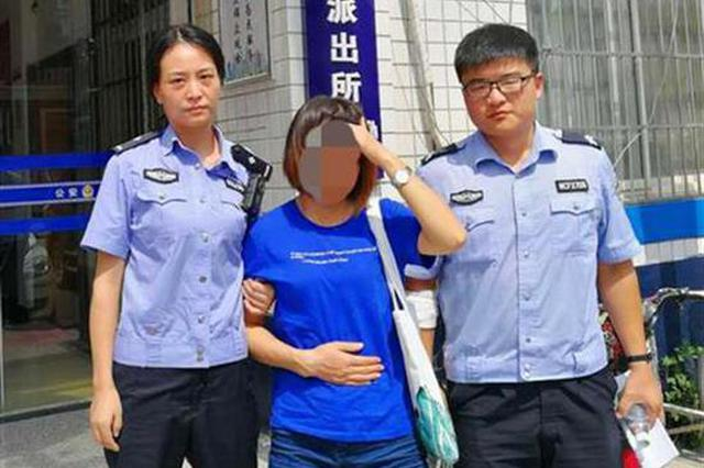 武汉女司机酒驾被查 咬住民警手臂踢打周围人
