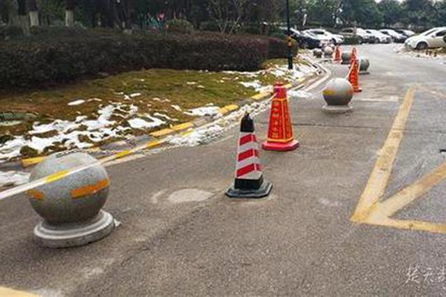 武汉一小区内沿路划线车位要取消 业主意见不一