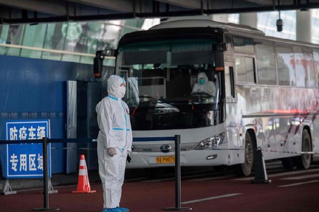 两名世卫专家过境新加坡时抗体呈阳性 未随团来访武汉