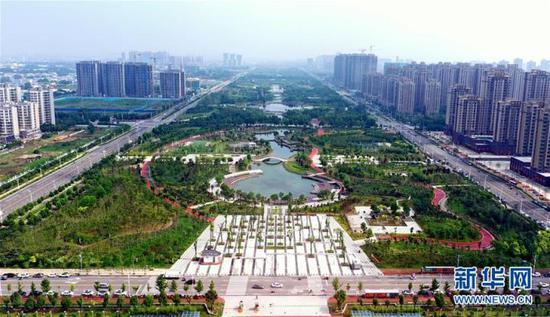 """15分钟""""圈""""出美好配资官网 。图为许昌中央公园(6月18日摄,无人机照片)。新华社记者李嘉南摄"""