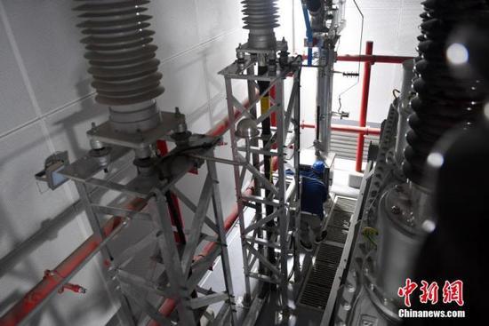 图为5月28日,河西110千伏输变电工程建设现场。  中新社记者 韩冰 摄
