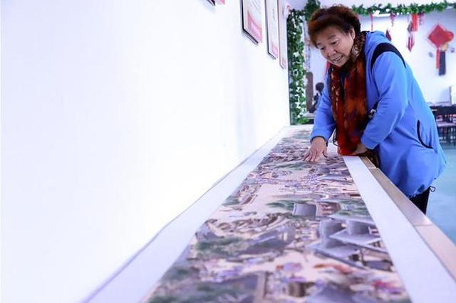 河北石家庄:刺绣艺人绣出8米长清明上河图