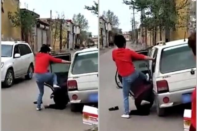 女子当街脚踹养母 被村民殴打砸车