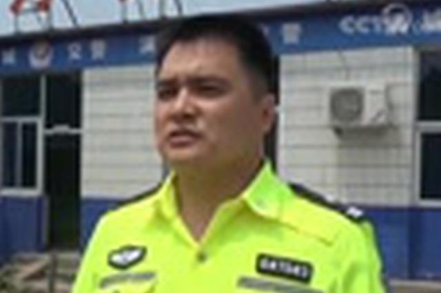 酒驾司机闯卡 拖行交警500米被拘