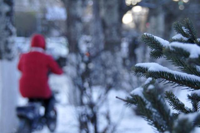 今日省内大部有雨雪 气温下降需保暖