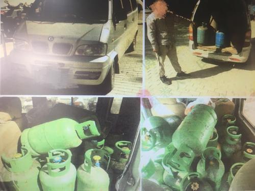 郑州闹市面包车载22个煤气罐上路 车主被拘留