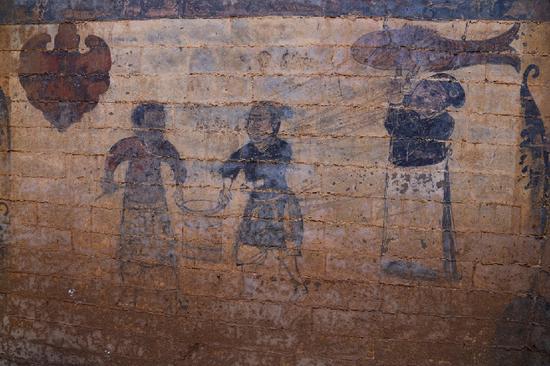 """东南壁壁画据推测为 """" 寺院施粥图 """"。"""