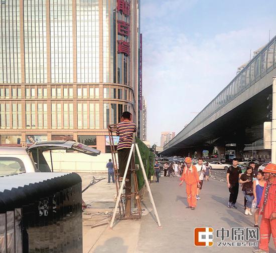 围而不建一律拆除 郑州二七广场西侧围挡拆后将建游园