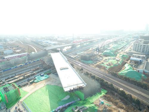 郑州大四环建设提速 西四环高架桥跨陇海铁路完成转体_中原网视台