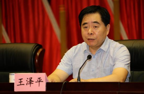 河南银监局局长王泽平