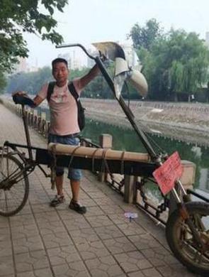 小伙自制40公斤重单车欲游全省
